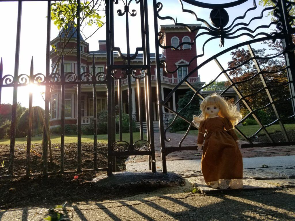 Creepy doll in front of the house of Stephen King in Bangor, Maine
