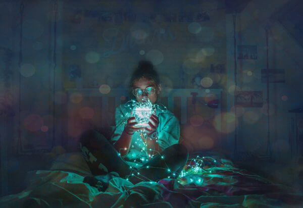 Girl holds a string of lights